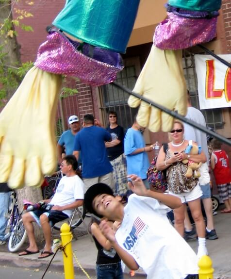 Giant Parade Puppet gets acquainted with a young fan!