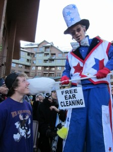 Stretch the nine foot clown in his Americana Costume. Never before has ear cleaning been so much fun!
