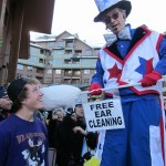 Stretch the nine foot clown in his Americana costume. Ear Cleaning was never before so much FUN!