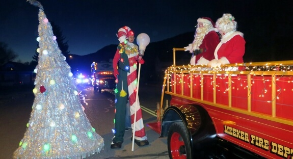 Santa and Mrs Claus on Parade with Stretch the Giant Candy Cane and Dancing Christmas Tree.